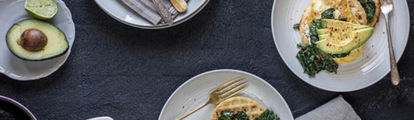 Gluten Free Savory Waffles with Garlicky Greens, Eggs, and Avocado